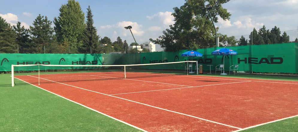 Two tennis courts with artificial grass
